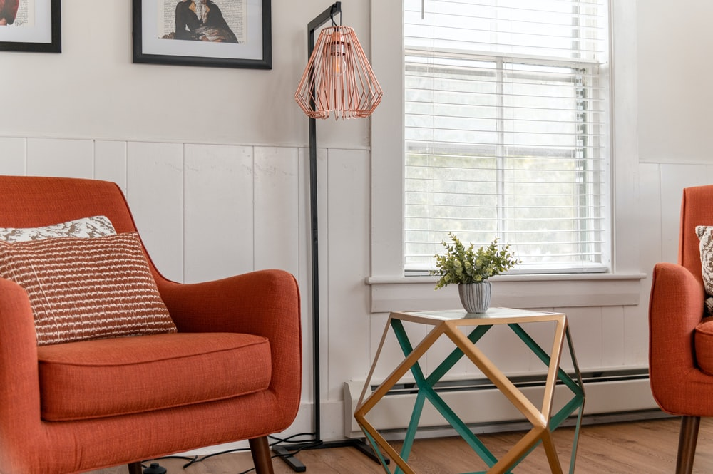 brown sofa chair near green table