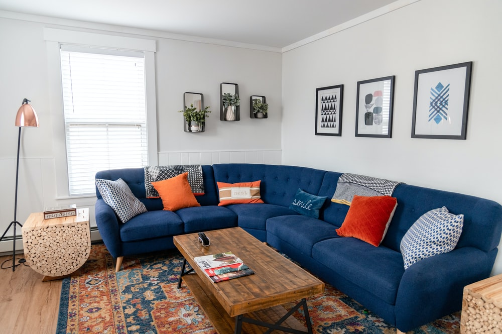 blue and brown couch with throw pillows
