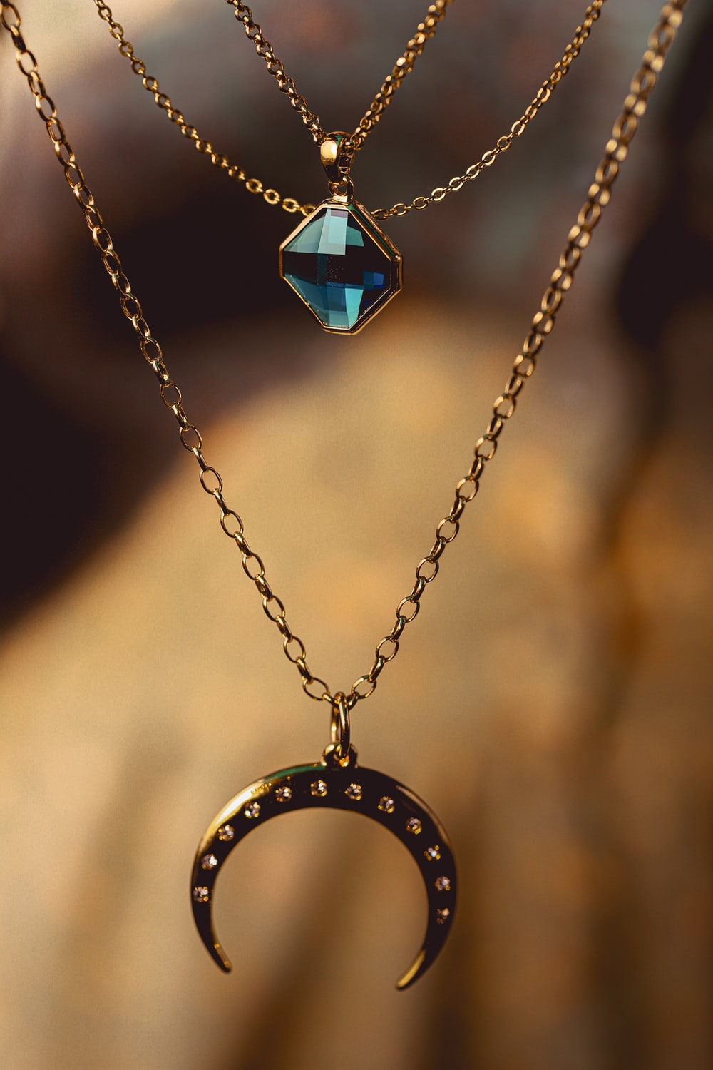 silver chain necklace with blue gemstone pendant