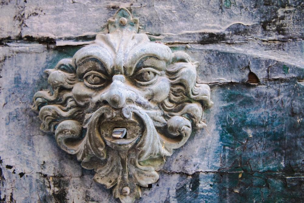 grey concrete lion head embossed wall decor