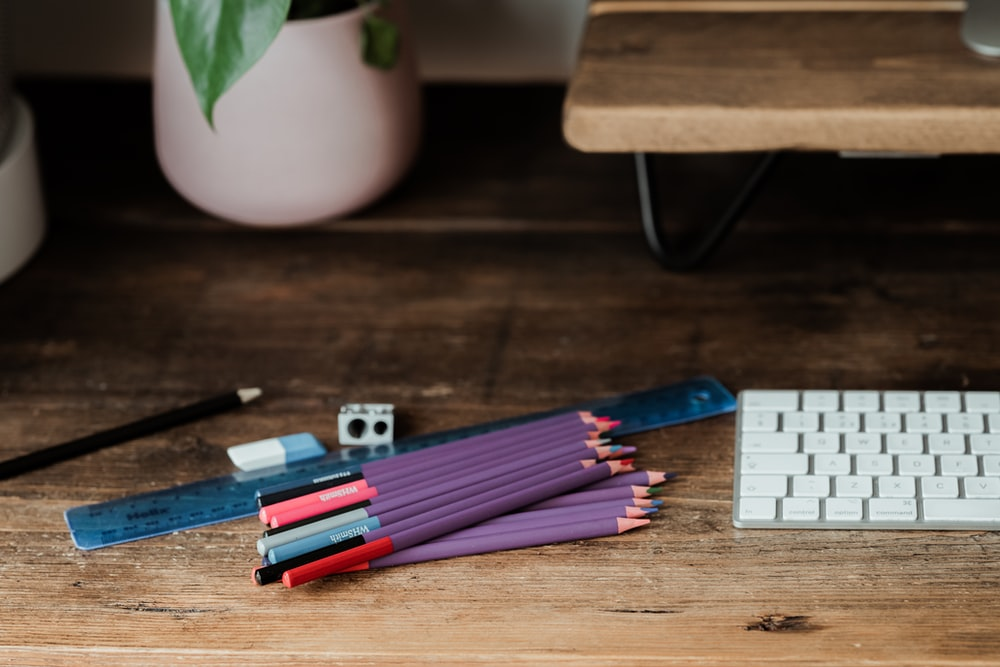 coloring pencils on brown wooden table