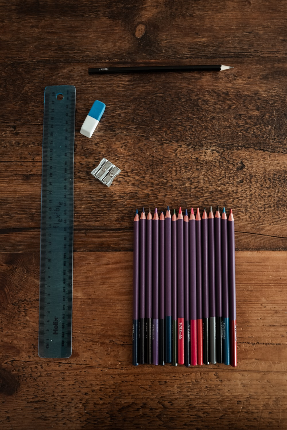 blue and white pencils on brown wooden table