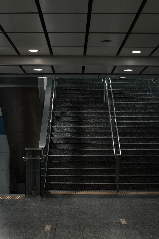 black and silver escalator in a room