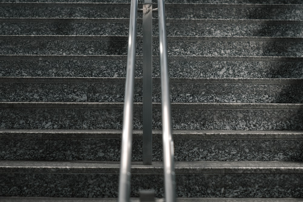 gray metal staircase with stainless steel railings