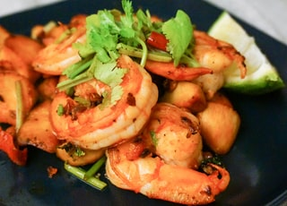 cooked shrimps on blue ceramic plate
