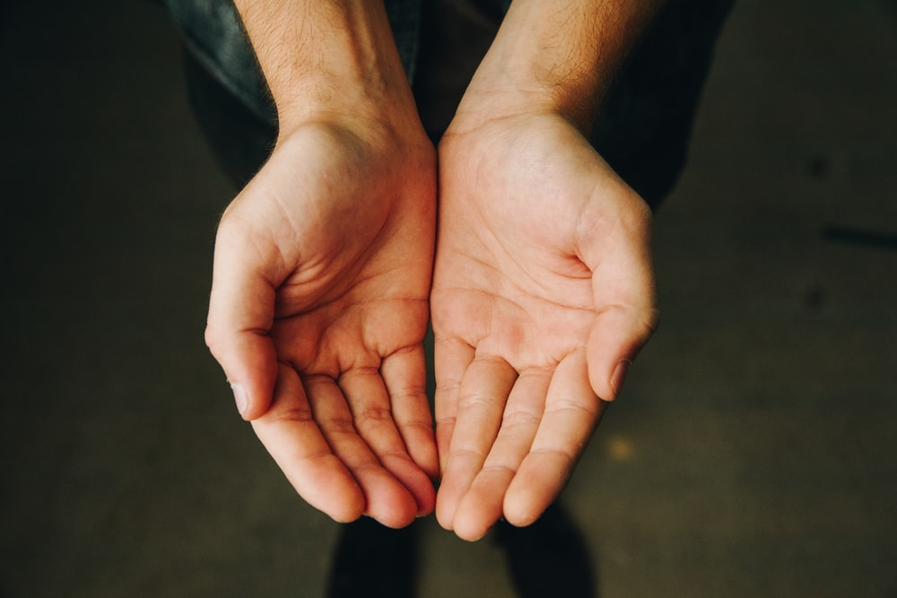 persons hand forming heart