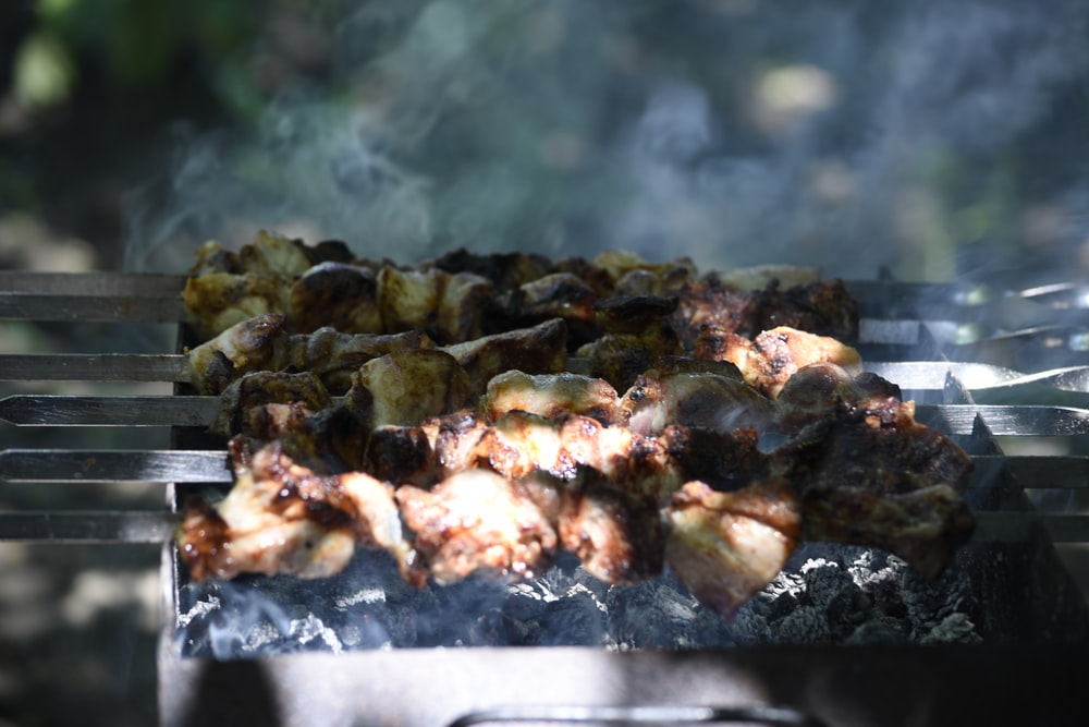 grilled meat on gray tray