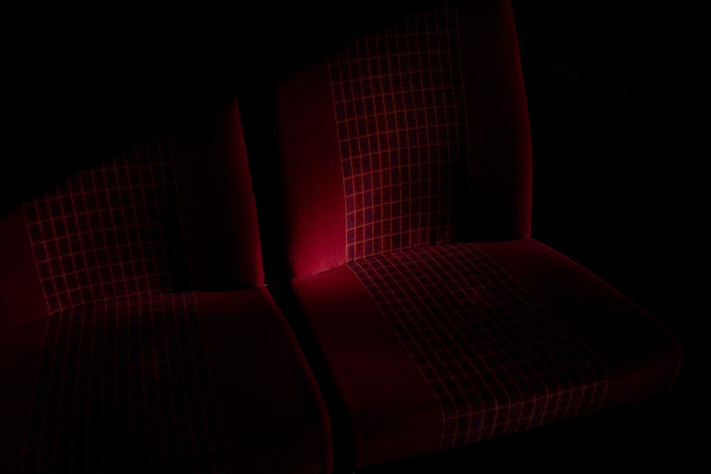 red sofa chair in dark room