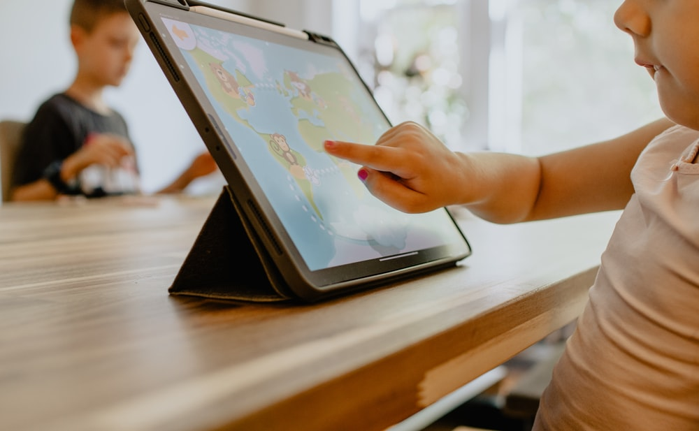 person using white tablet computer