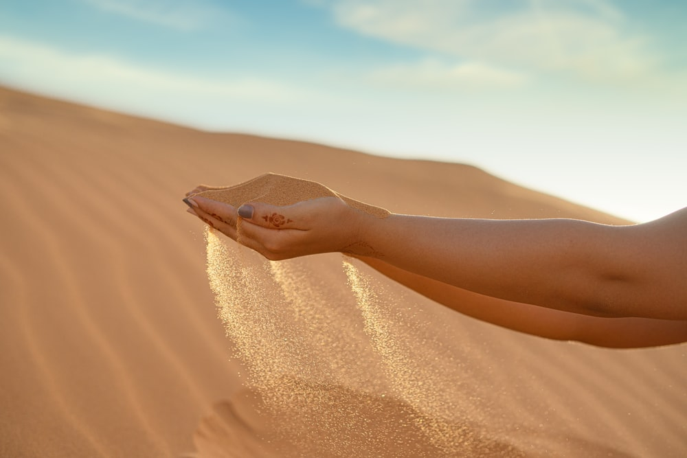 person in brown sand during daytime