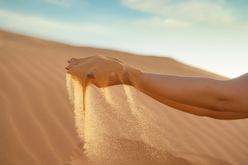 person on desert during daytime