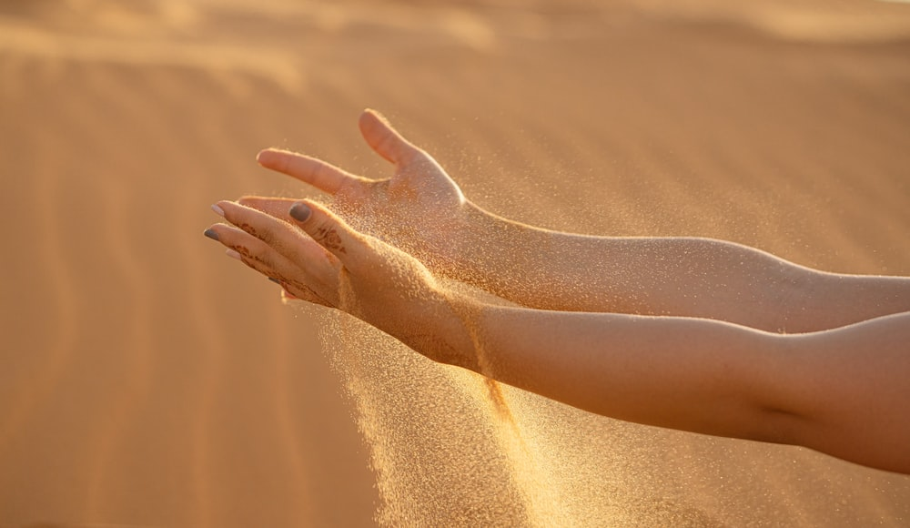 persons feet on brown sand