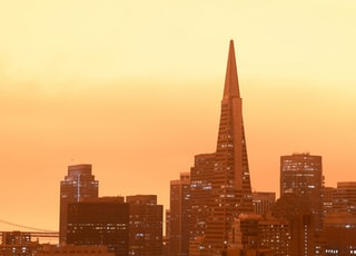 city skyline during sunset with brown sky