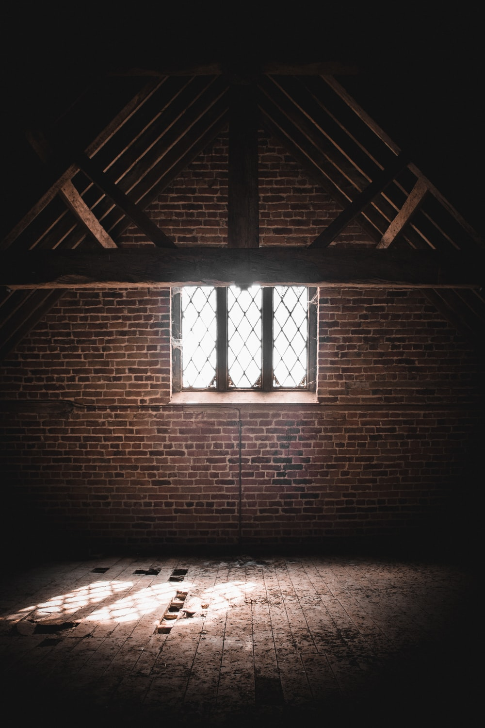 brown wooden window frame on brown brick wall