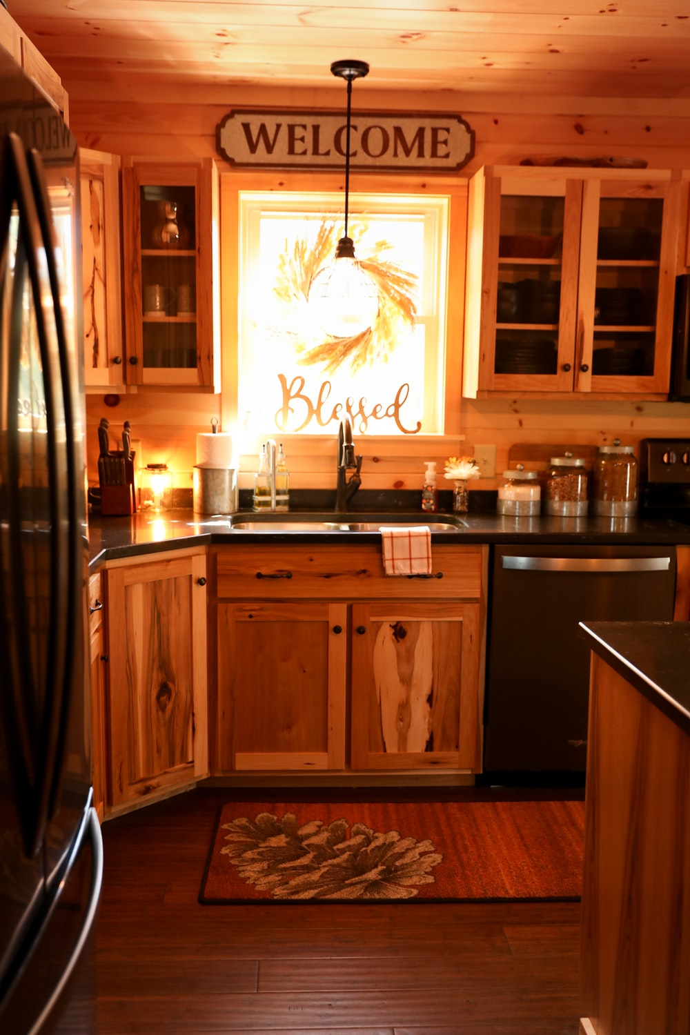 brown wooden kitchen cabinet with white wooden cabinet