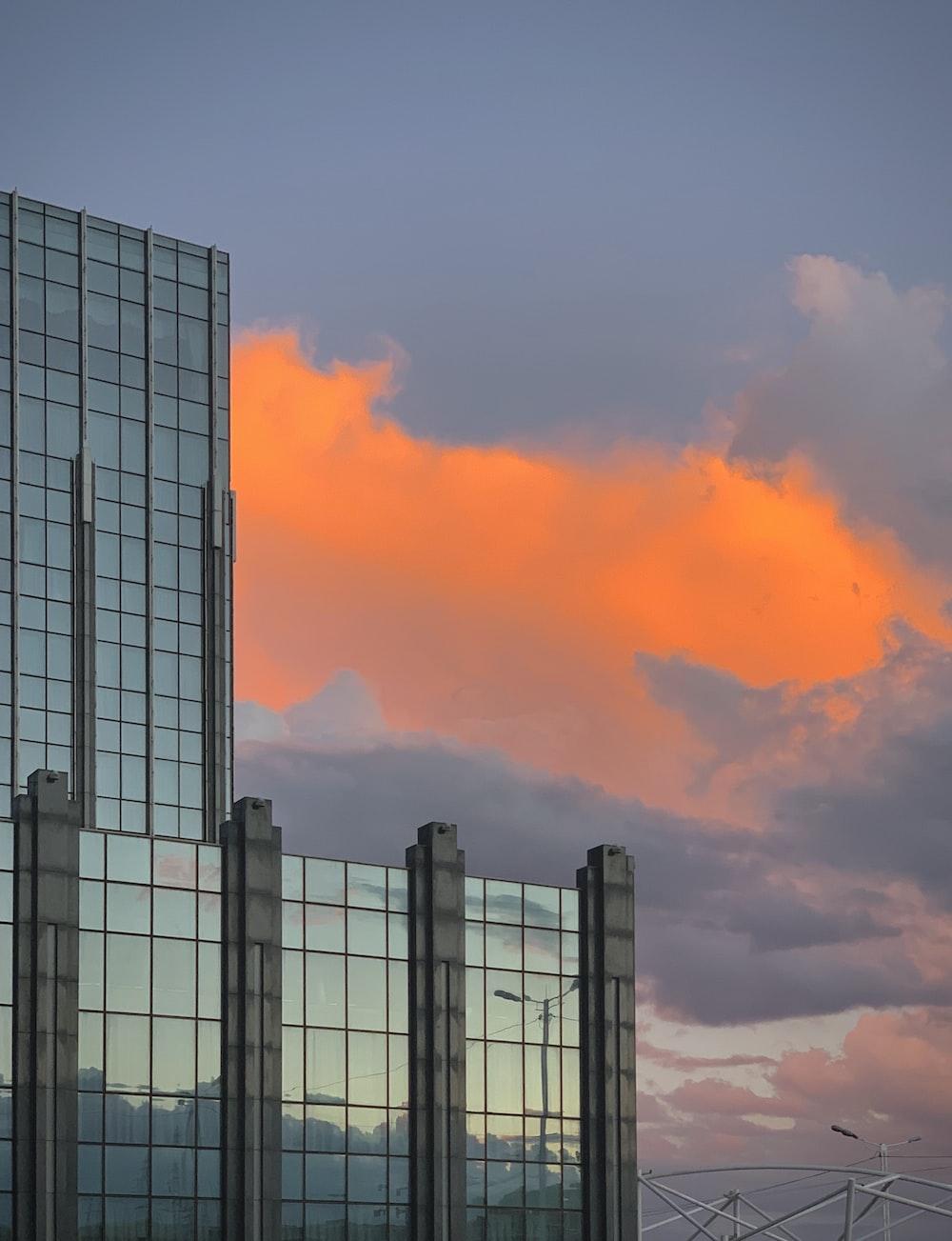 gray concrete building under orange clouds
