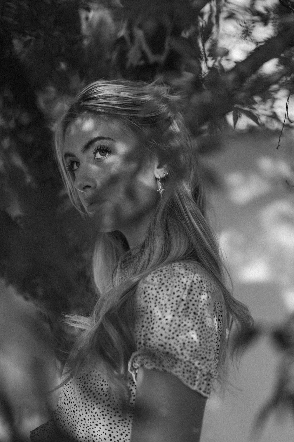 grayscale photo of woman in polka dot shirt