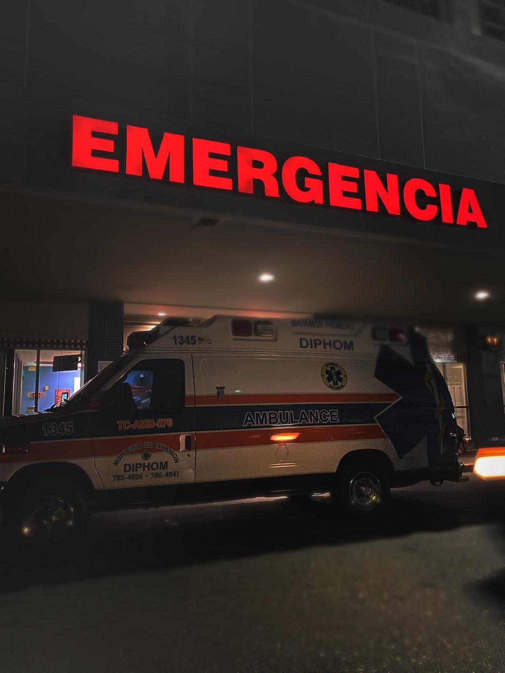 white and red ambulance van