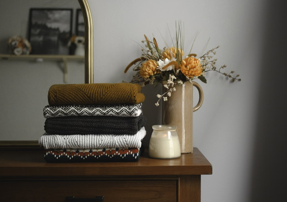 brown and white towel on brown wooden table