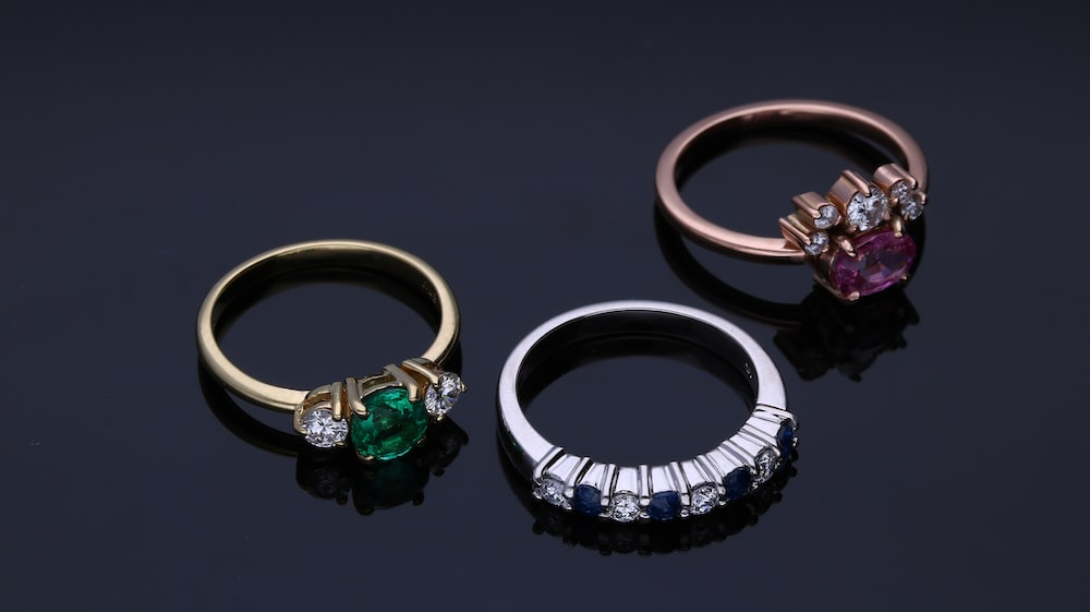 silver and green stone ring