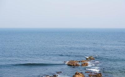 Visakhapatnam brown rock formation on sea during daytime