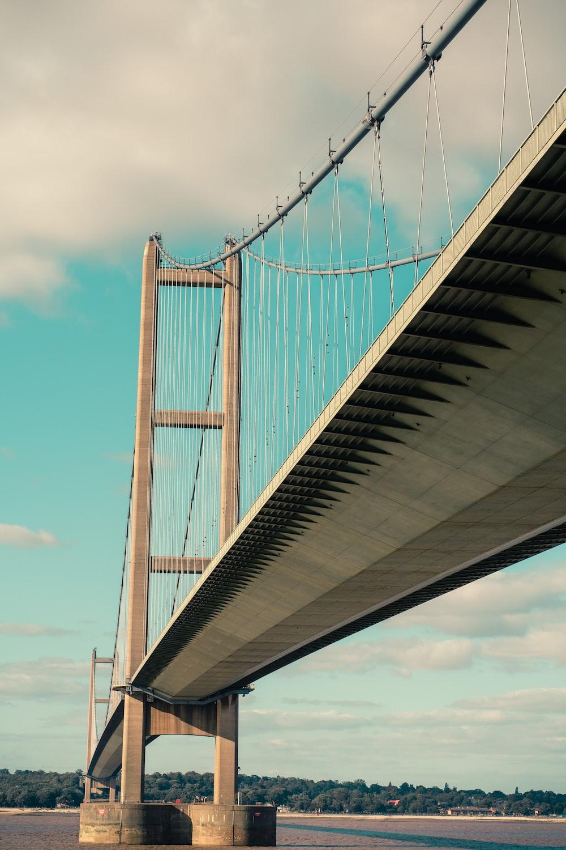 gray bridge under blue sky during daytime