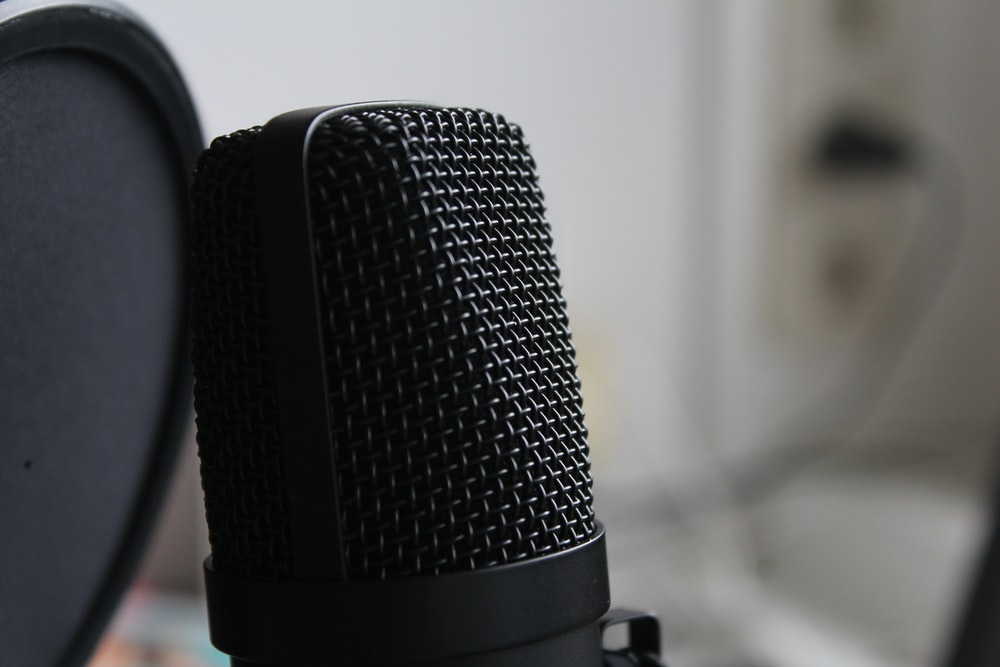 black microphone on white table