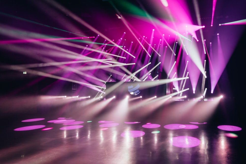 purple and blue lights on stage