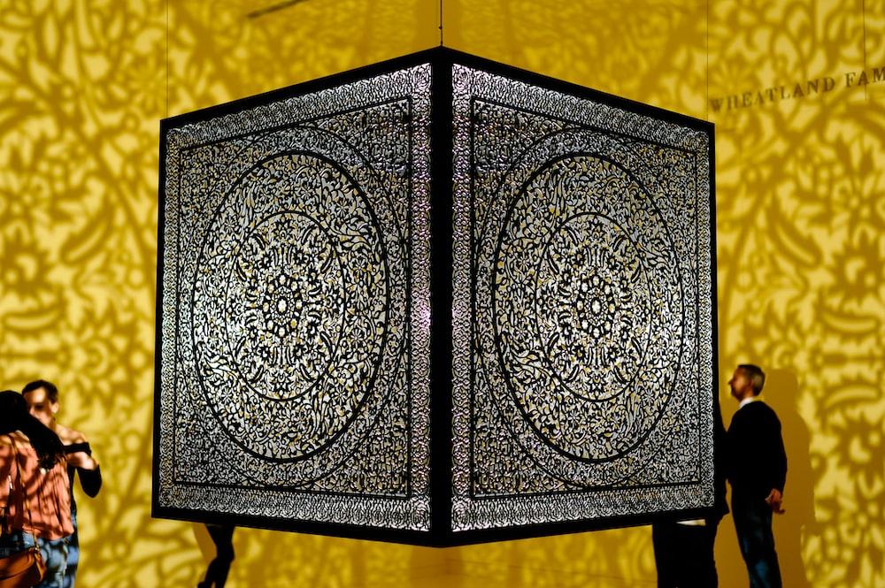 black wooden frame on yellow textile