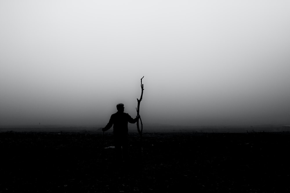 silhouette of person standing on ground