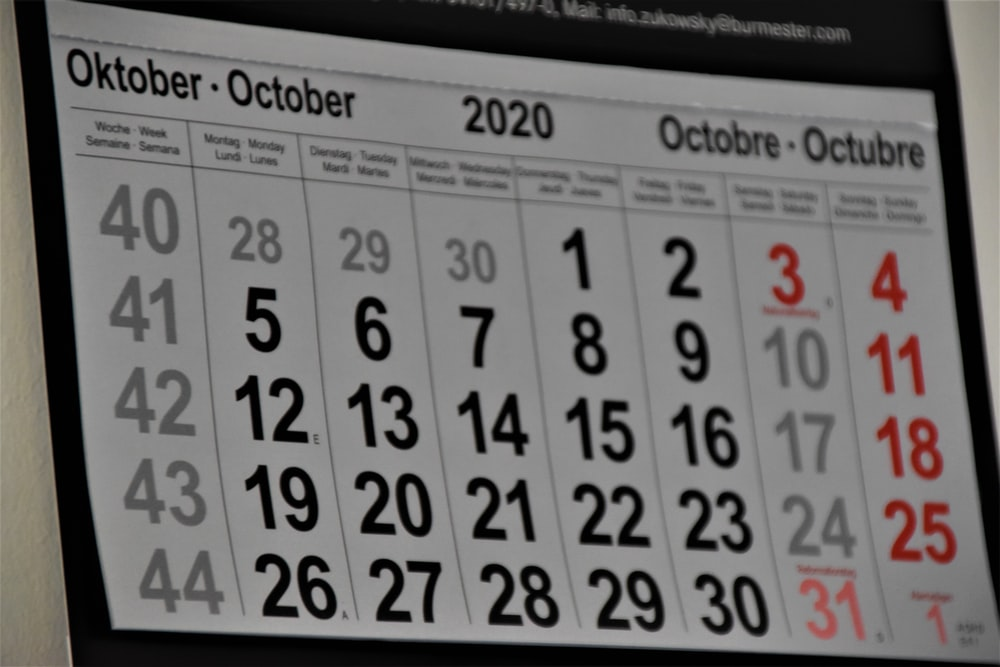black and white calendar on white wall
