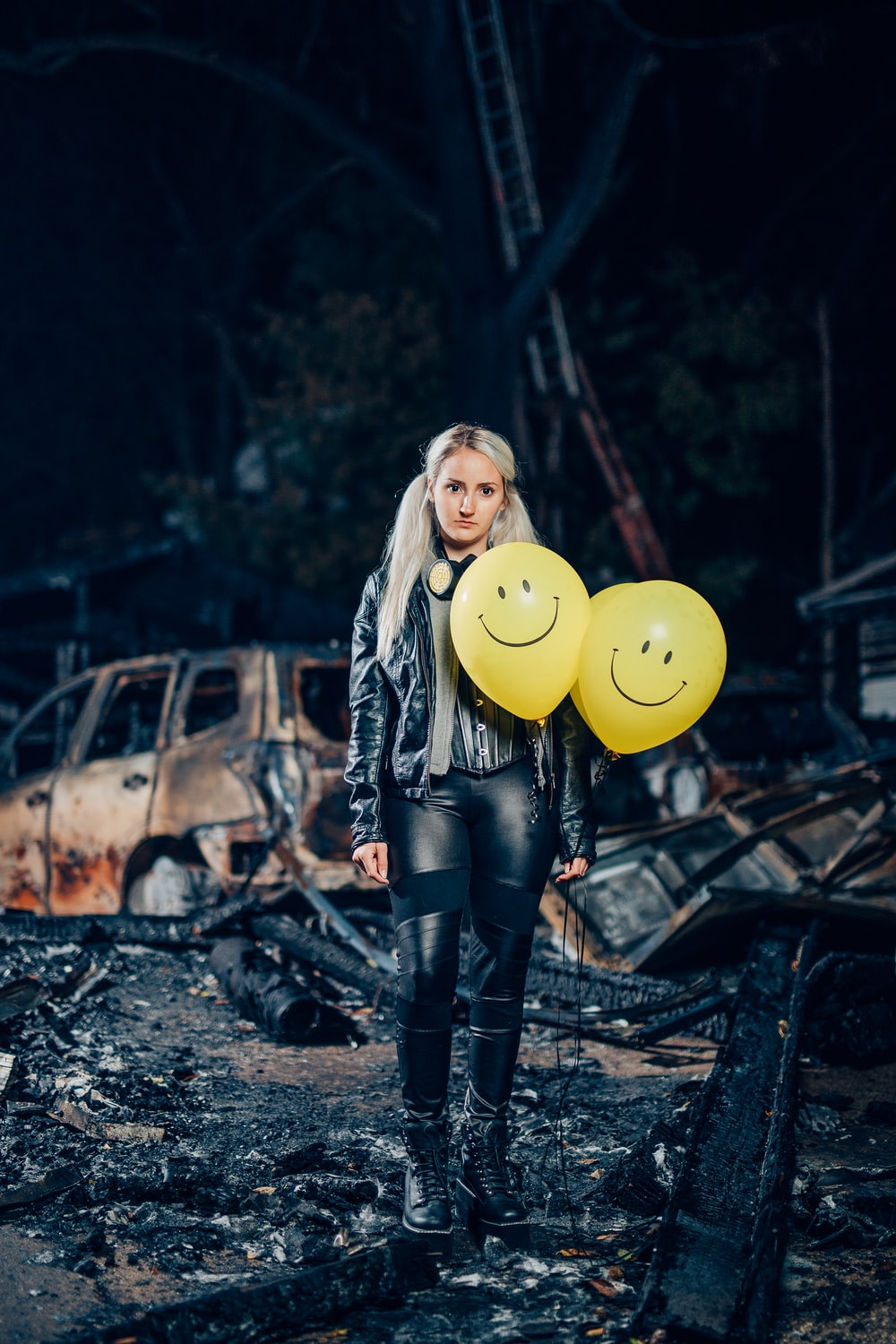 woman in black leather jacket holding yellow balloon
