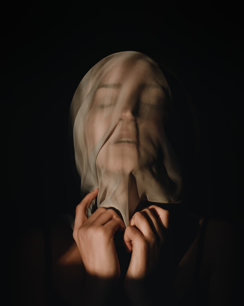 person covering face with hands
