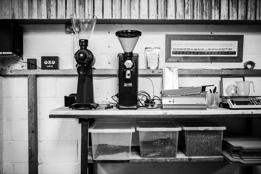 black and silver coffee maker on black table