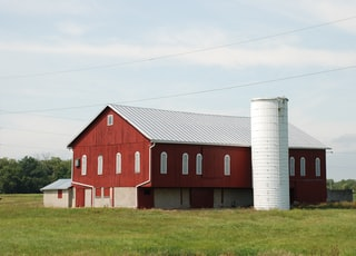 Old Red Barn with white silo