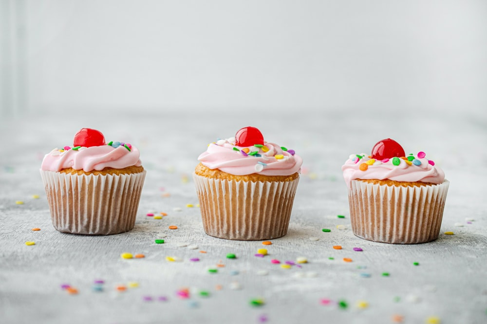cupcakes with red and white icing on top