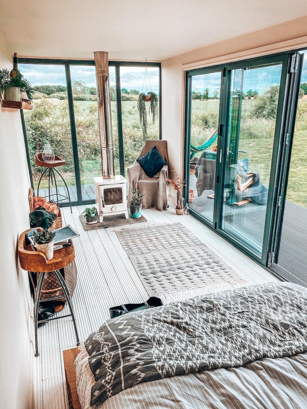 brown wooden chair near glass sliding door