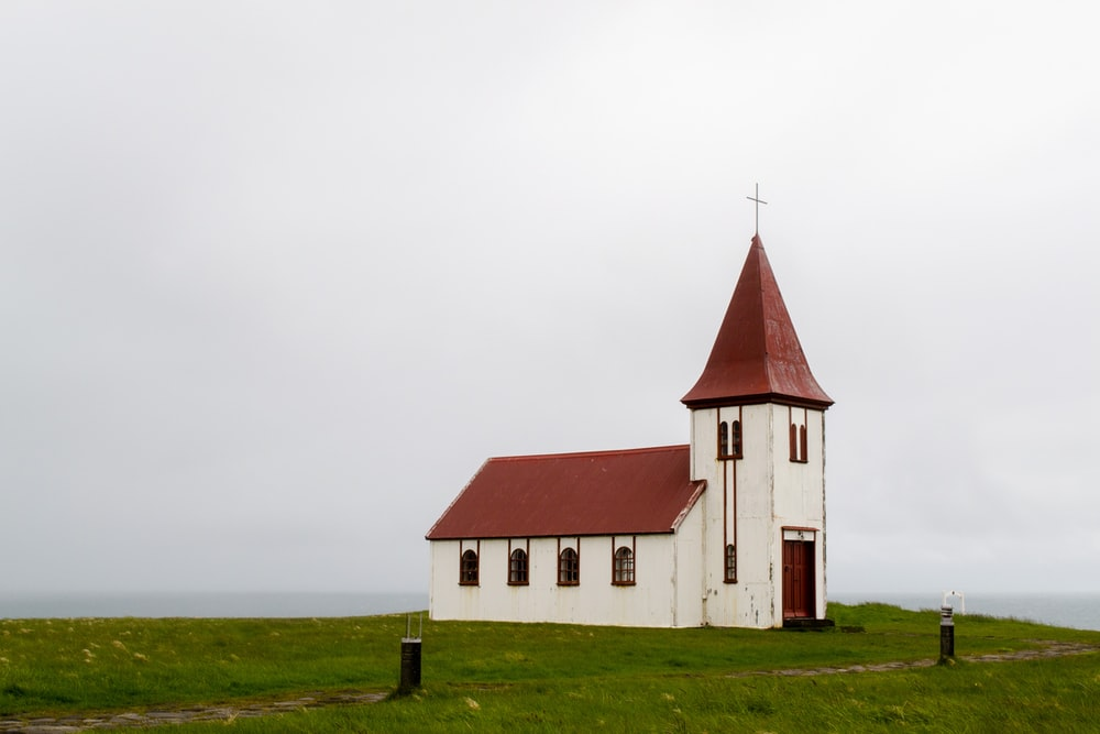 white and red concrete church