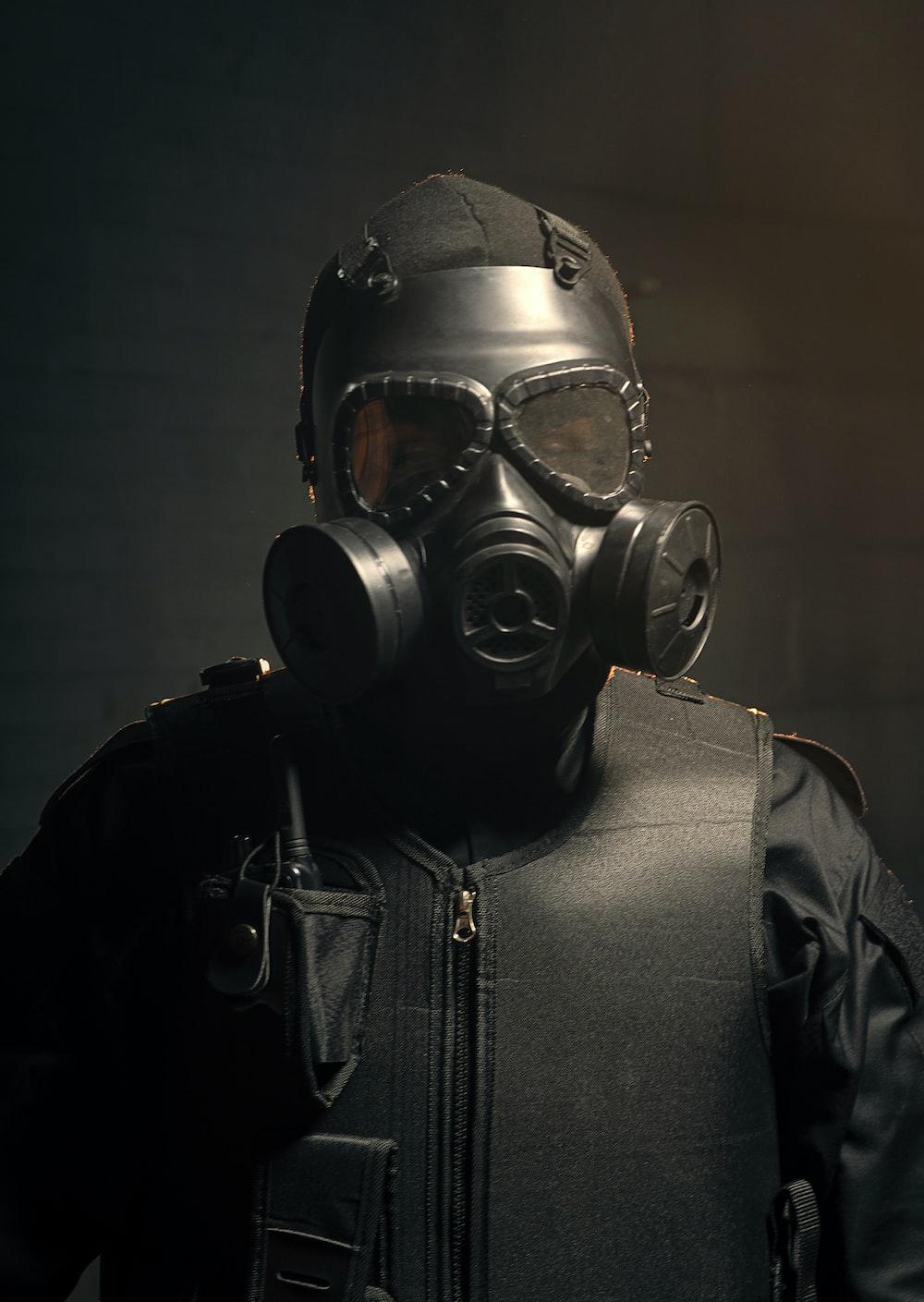 man in black leather jacket wearing gas mask