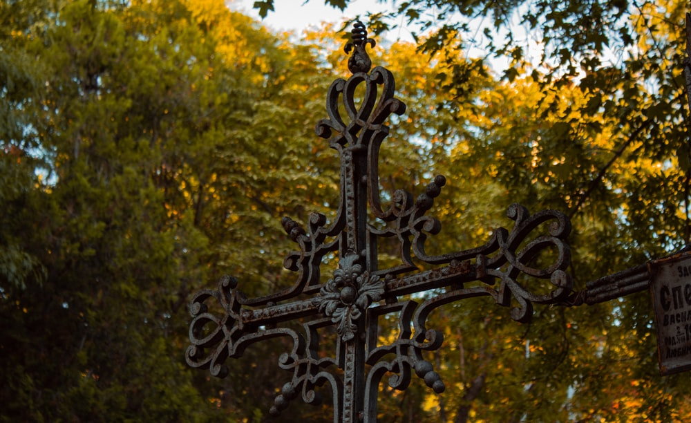 black cross with yellow leaves