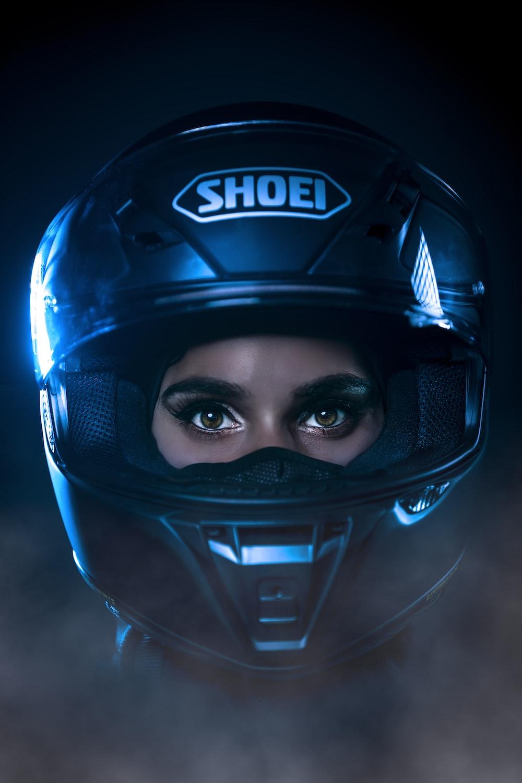 black and blue helmet on black surface
