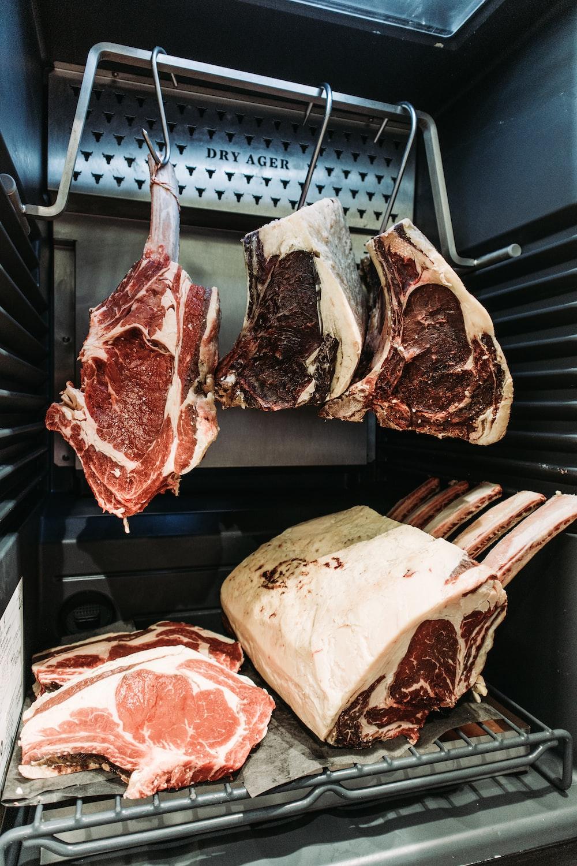 raw meat on black metal grill
