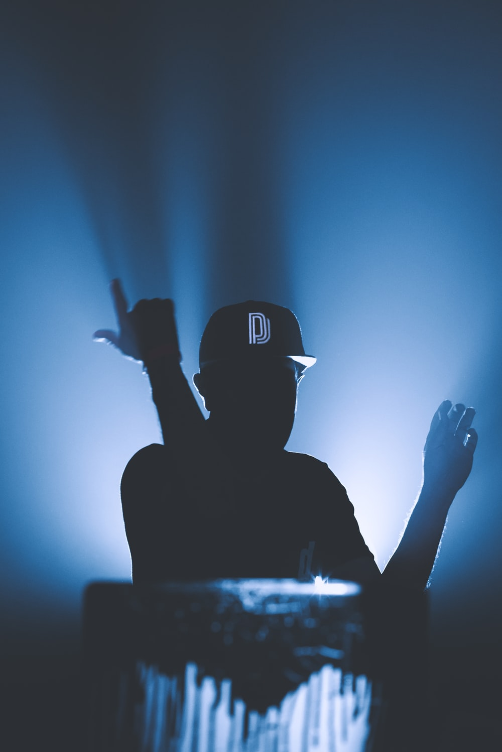silhouette of man wearing black cap