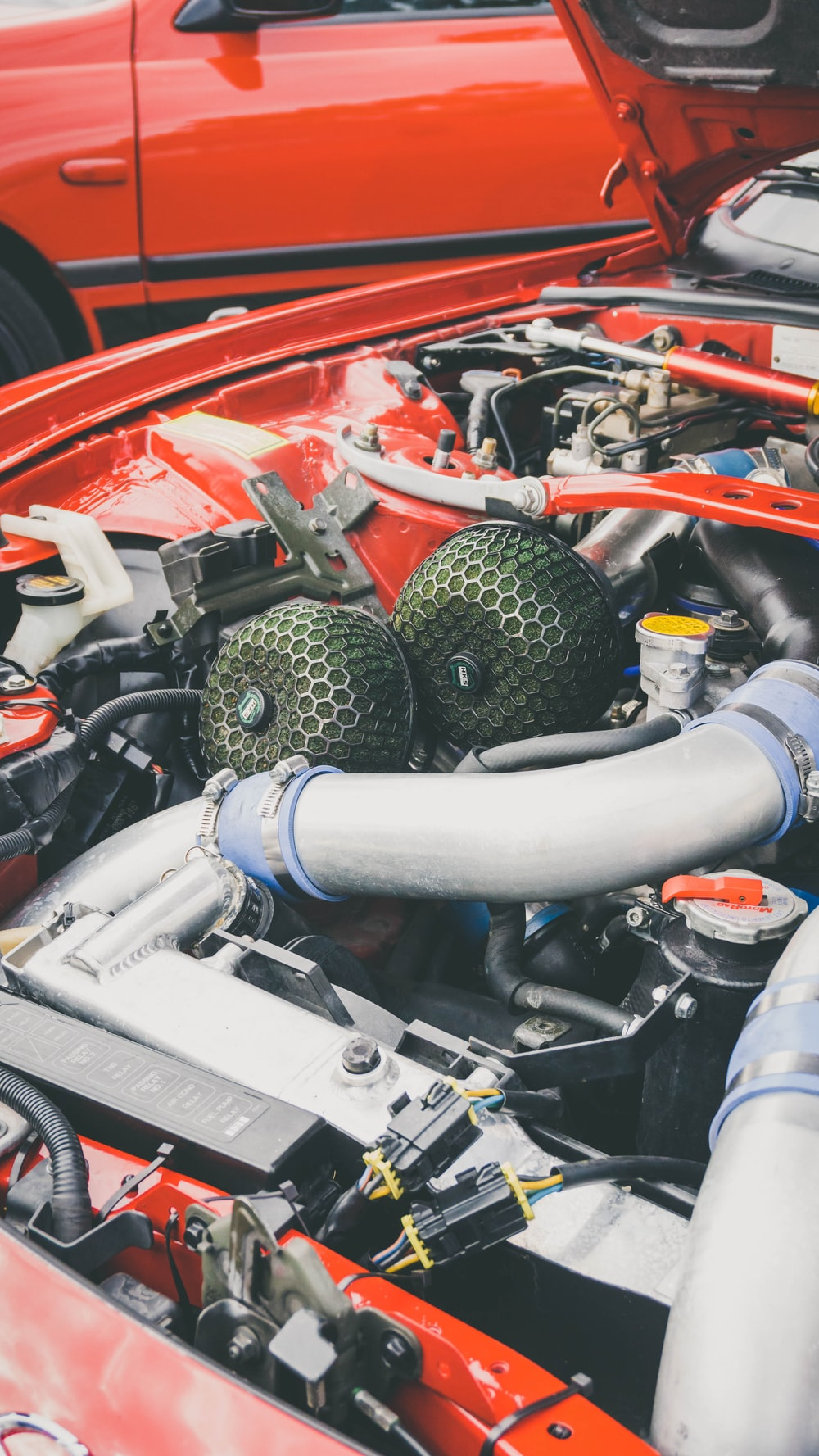 red and gray car engine
