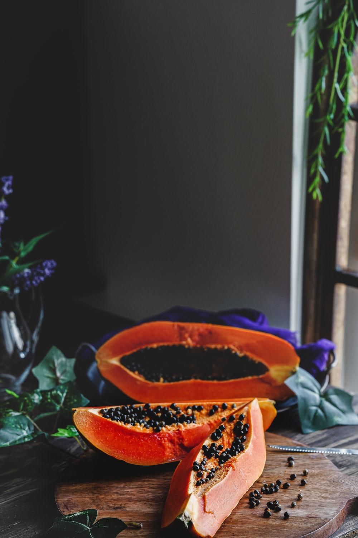 orange flower in brown pot