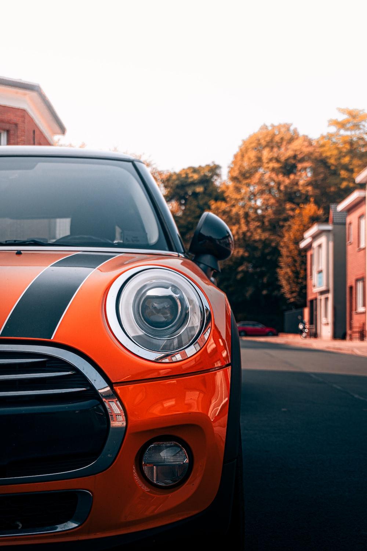 orange and black car on road during daytime
