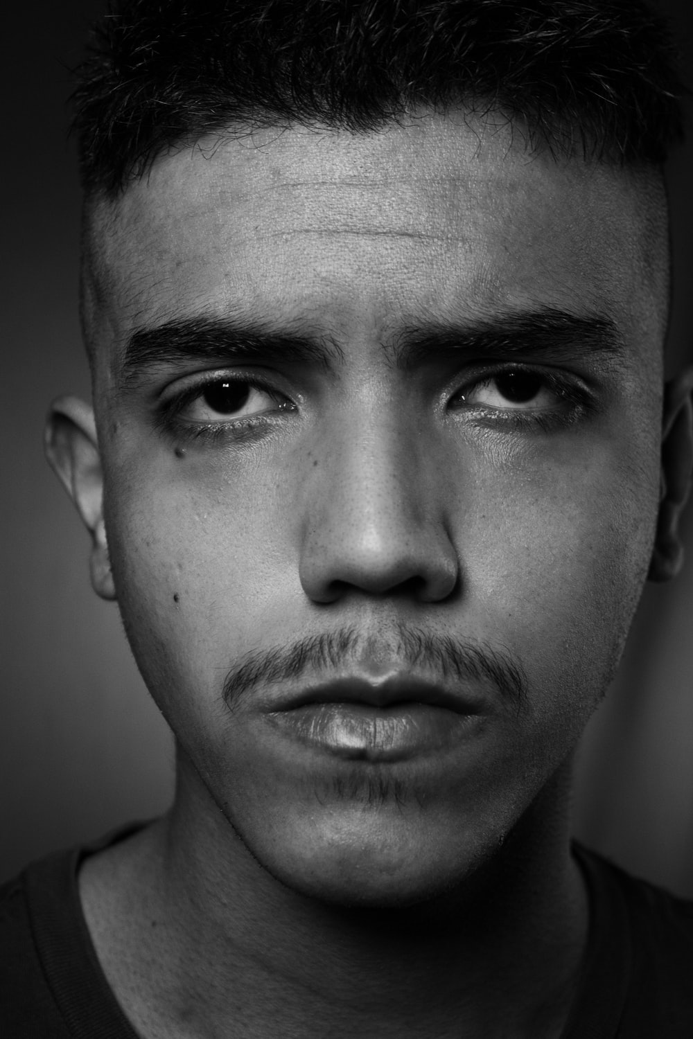 mans face in grayscale