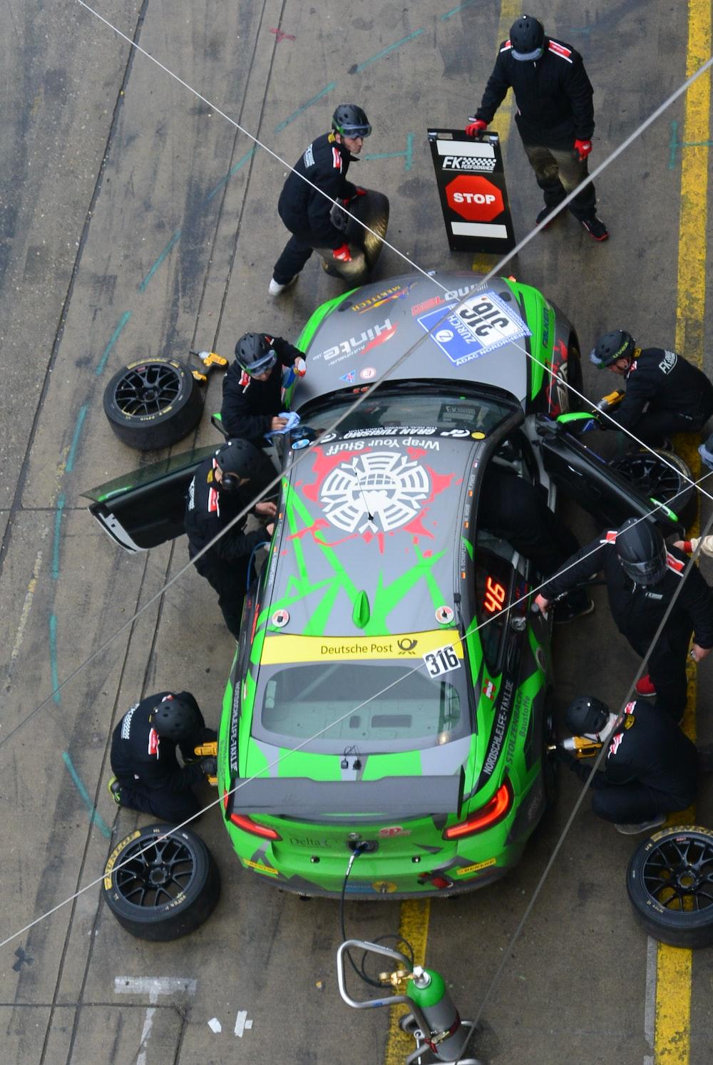 green and black racing car