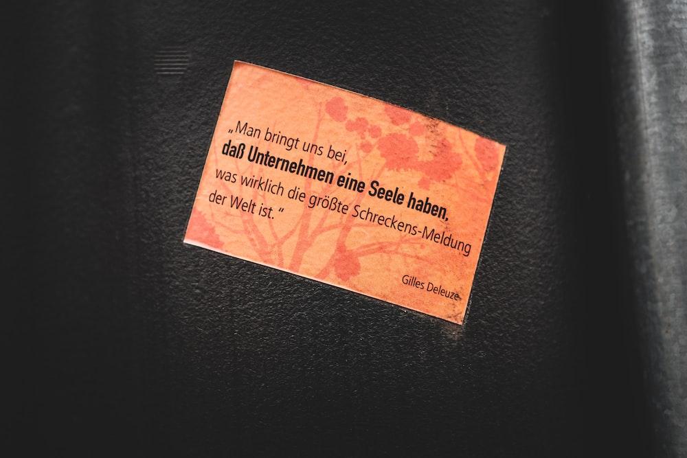 pink sticky note on black textile