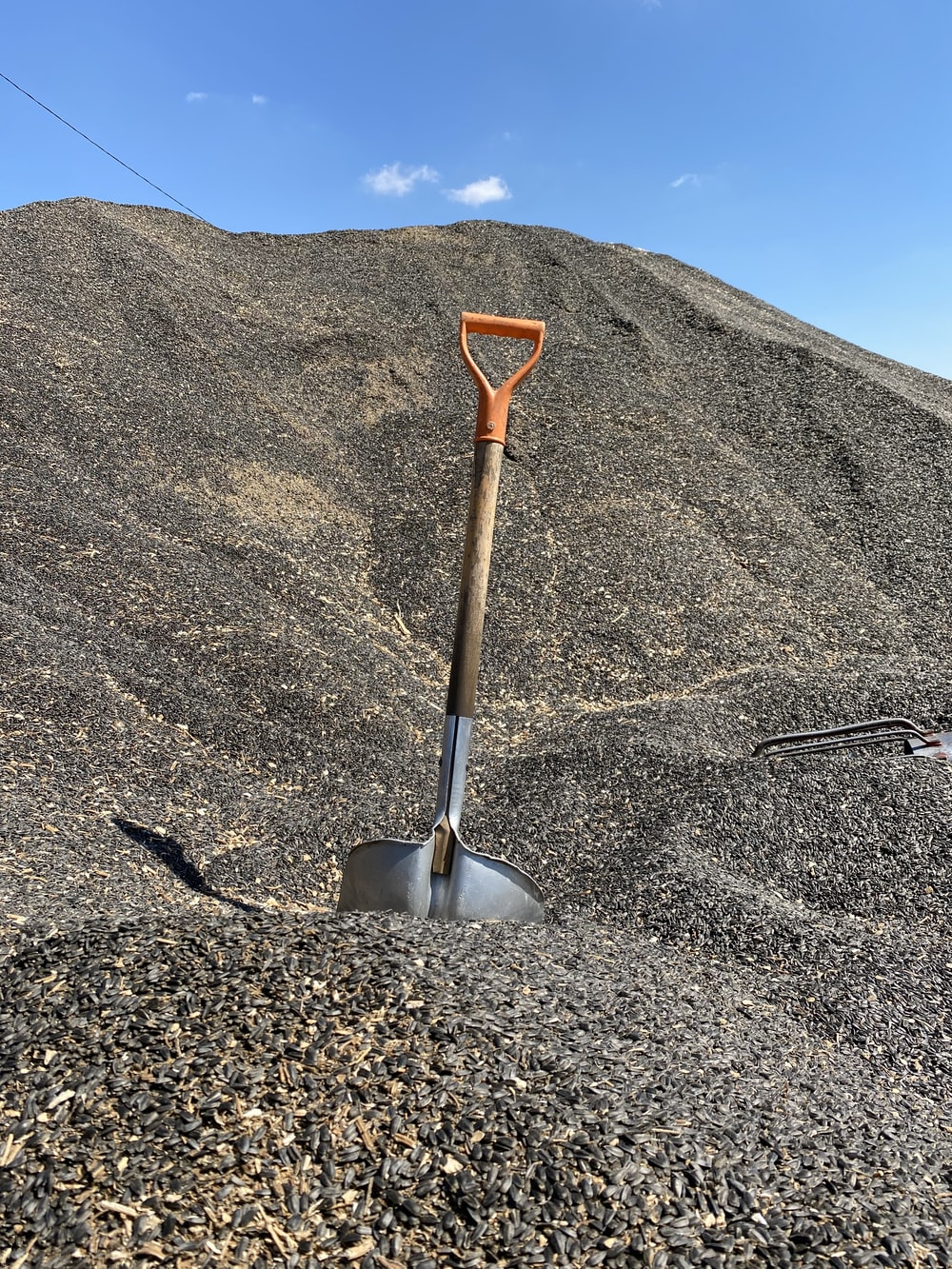 red and gray shovel on gray sand